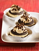 Three Cream Filled Chocolate Cookies with Chocolate Shavings; In Muffin Cups