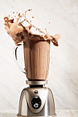 Chocolate Protein Shake Splashing from a Blender