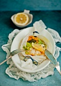 Fish fillets with vegetables in parchment paper