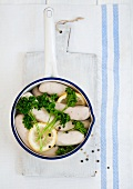 White sausage with parsley in a pot