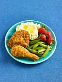 Fried Chicken with Mashed Potatoes, Strawberries and Snap Peas