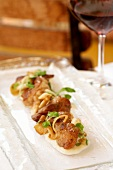 Pan Fried Chicken on a Narrow Platter; Glass of Wine