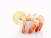 Shrimp Cocktail in a Small Bowl with Lemon Slice; White Background