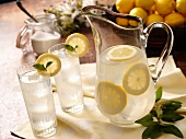 Pitcher and Two Glasses of Lemonade; Sugar Jar and Basket of Lemons