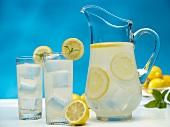 Pitcher and Glasses of Fresh Lemons