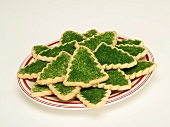 Christmas Sugar Cookies; Christmas Trees with Green Sugar Sprinkles on a Plate; White Background