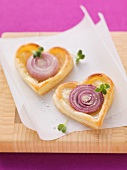 Heart-shaped puff pastry onion tartlets
