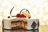 A layer cake topped with berries and a macaroon
