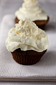 Chocolate cupcakes with coconut frosting