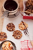 Florentines being decorated with chocolate icing