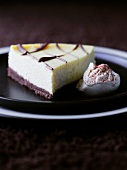 A slice of cheese cake with chocolate