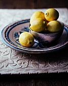 Lemon in a silver plate on a plate