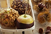Caramel apples with maple syrup, chocolate and roasted hazelnuts