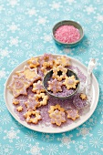 Star-shaped biscuits with purple sugar