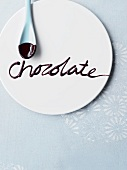 The word 'chocolate' written on a plate