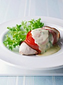 Chicken breast wrapped in ham with a tomato and herb sauce