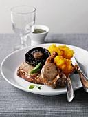 Roast lamb with carrot and potato puree and mushrooms