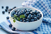Blueberries on a blue checked cloth