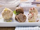 Bread dumplings with cheese, black bread dumplings and bacon dumplings