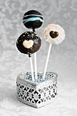 Cake pops stuck in a silver box