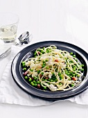 Linguine with peas, ricotta and diced bacon