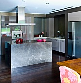 A monolithic block as an island counter in a designer kitchen