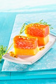 Melon and salmon canapes with passion fruit sauce