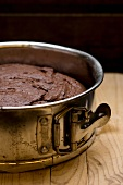 Chocolate cake in a cake tin