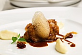 Veal sweetbreads with nougat sauce, mashed potatoes and coffee foam