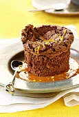 Chocolate souffle with orange sauce and orange zest