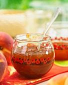 Peach jam in a glass bowl