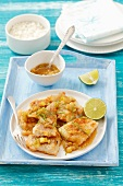 Fried cod with garlic, ginger and limes