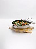 Sautéed vegetables in a pan