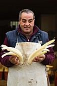 A man holding cardoons (Piedmont)