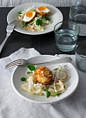 White cabbage and apple salad with breaded cheese eggs