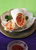 Spicy tomato burrito with chilli flakes