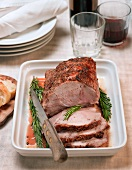 Sliced roast pork with rosemary