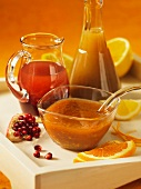 Various dressings with pomegranate and oranges