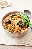 Couscous with pork, chickpeas, carrots and prunes