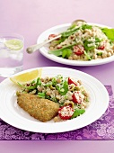 Breaded fish fillet with chickpea couscous