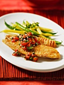 Tilapia fillet with a tomato and caper salsa and a bean medley