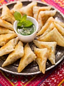 Prawn samosas with a herb dip