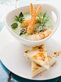 Yogurt and herb soup with king prawns