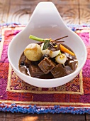 Braised beef cheeks with May turnips