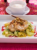 Fried saddle of pork with pointed cabbage and quinces