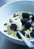 White chocolate cream with pumpkin seeds and blackberries