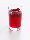 A glass of raspberry jelly