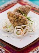 Minced meat bulgur dumplings on a radish salad