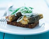 Smörrebröd topped with fried herring (Denmark)