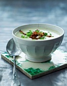 Cream of vegetable soup with bacon and chives